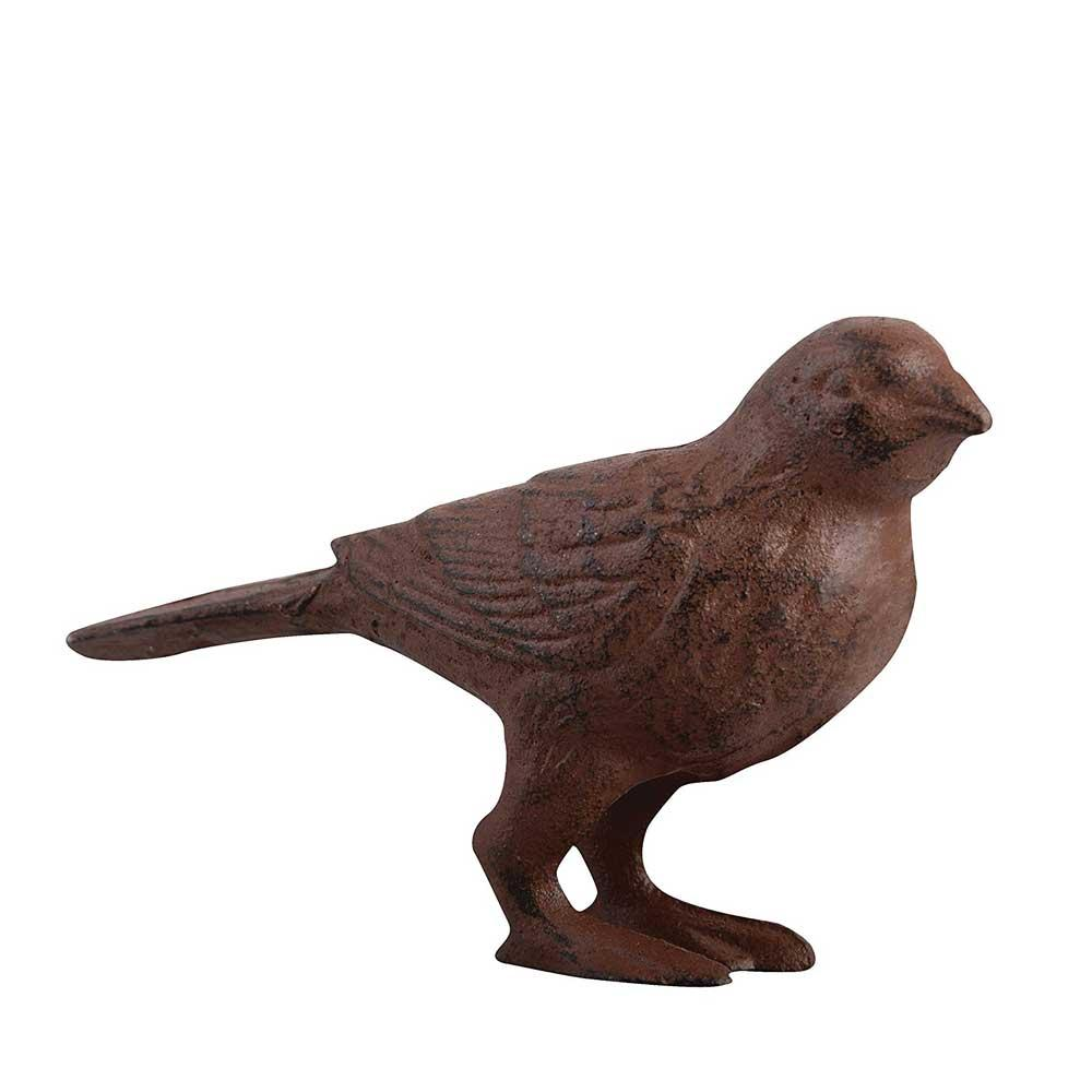 Rostig fågel i gjutjärn