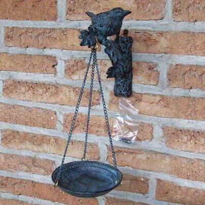 Fågelbad i brons